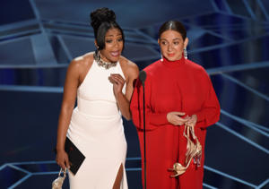 Tiffany Haddish, left, and Maya Rudolph present the award for best documentary short subject at the Oscars on Sunday, March 4, 2018, at the Dolby Theatre in Los Angel