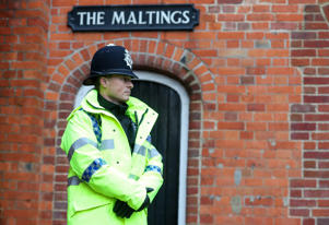 A police officer outside The Mill pub near to the Maltings in Salisbury