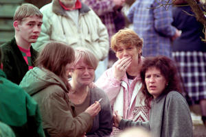 Grieving parents waiting to hear the news of the shooting incident at Dunblane primary school, near Stirling.