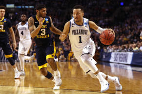 CAPTION: BOSTON, MA - MARCH 23: Jalen Brunson #1 of the Villanova Wildcats is defended by James Bolden #3 of the West Virginia Mountaineers during the second half in the 2018 NCAA Men's Basketball Tournament East Regional at TD Garden on March 23, 2018 in Boston, Massachusetts.