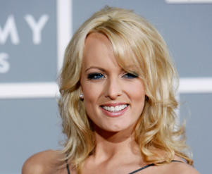 FILE - In this Feb. 11, 2007 file photo, Stormy Daniels arrives for the 49th Annual Grammy Awards in Los Angeles. A nonprofit watchdog group has asked the Justice Department and Office of Government Ethics to investigate whether a secret payment to Daniels made prior to the 2016 presidential election violated federal law because Donald Trump did not list it on his financial disclosure forms.