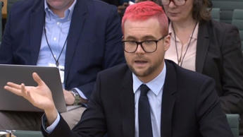 A video grab from footage broadcast by the UK Parliament's Parliamentary Recording Unit shows Canadian data analytics expert Christopher Wylie appearing as a witness before the Digital, Culture, Media and Sport Committee of members of the British parliament at the Houses of Parliament in central London on Tuesday. (AFP)