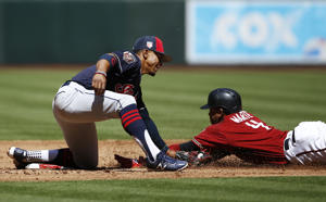 Cleveland Indians shortstop Francisco Lindor, left, puts the tag down on Arizona Diamondbacks' Ketel Marte (4) for an out as Marte attempts to steal second base during the second inning of a spring training baseball game Tuesday, March 27, 2018, in Phoenix. (AP Photo/Ross D. Franklin)