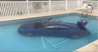 Carpooling? Car splashes into pool after driver forgets handbrake