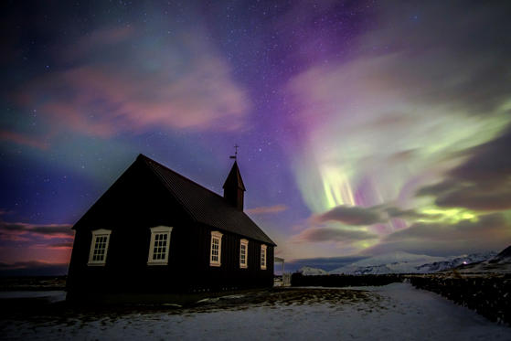Slide 1 of 14: Green Aurora borealis over Alesund, Norway