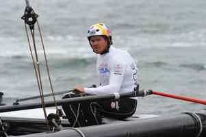 Oracle Team USA skipper Tom Slingsby during a training run on Sydney Harbour with Team Australia in Sydney.