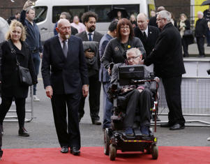 FILE - In this file photo dated Monday, 30 March, 2015, Professor Stephen Hawking, front right, and Professor Kip Thorne, left, arrive for the Interstellar Live show at the Royal Albert Hall in London.