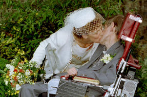 A kiss for scientist and theorist Stephen Hawking from his new bride Elaine Mason after their civil wedding September 15, 1995. Picture taken September 15, 1995. REUTERS/Paul Bates