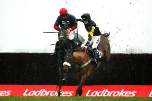 File: Harry Cobden jumps the last on Elegant Escape ahead of Bryony Frost