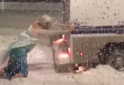 Watch manly 'Elsa' rescue police vehicle in the snow