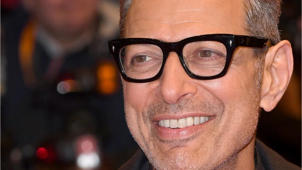 Jeff Goldblum wearing glasses and smiling at the camera: Jeff Goldblum knows we're doing impressions of him — and he likes it