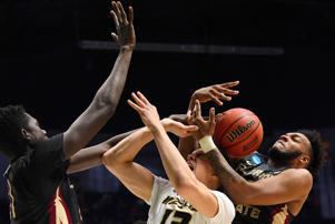 Mar 16, 2018; Nashville, TN, USA; Missouri Tigers forward Michael Porter Jr. (13) goes for a rebound with Florida State Seminoles center Christ Koumadje (21) and guard PJ Savoy (5) during the first half in the first round of the 2018 NCAA Tournament at Bridgestone Arena.