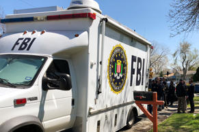 Law enforcement personnel incluing FBI agents are seen near a home that was hit with a parcel bomb in Austin, Texas, U.S., March 13, 2018.