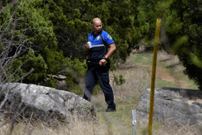 A member of Austin Police Department holds a perimeter on a nature trail near Mission Oaks Boulevard following an explosion in Austin, Texas, U.S., March 19, 2018.