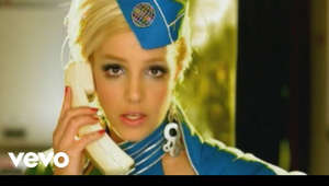 a person wearing a hat: Britney Spears' official music video for 'Toxic'. Click to listen to Britney Spears on Spotify: http://smarturl.it/BritneySpot?IQid=B...  As featured on Greatest Hits: My Prerogative. Click to buy the track or album via iTunes: http://smarturl.it/BritneyGHiTunes?IQ... Google Play: http://smarturl.it/BritneyToxPlay?IQi... Amazon: http://smarturl.it/BreatneyGreatAmz?I...  More from Britney Spears Make Me... Ft. G Eazy: https://www.youtube.com/watch?v=etfJC... Criminal: https://youtu.be/s6b33PTbGxk I Wanna Go: https://youtu.be/T-sxSd1uwoU Hold It Against Me: https://youtu.be/-Edv8Onsrgg  Follow Britney Spears Website: http://www.britneyspears.com/ Facebook: https://www.facebook.com/britneyspears Twitter: https://twitter.com/britneyspears Instagram: https://instagram.com/britneyspears Tumblr: http://britneyspears.tumblr.com/  Subscribe to Britney Spears on YouTube: http://smarturl.it/BritneySub?IQid=Br...  More great nineties videos here: http://smarturl.it/Ultimate00?IQid=Br...  ---------  Lyrics:  Baby, can't you see I'm calling A guy like you Should wear a warning It's dangerous I'm fallin'  There's no escape I can't wait I need a hit Baby, give me it You're dangerous I'm lovin' it  Too high Can't come down Losing my head Spinning 'round and 'round Do you feel me now  With a taste of your lips I'm on a ride You're toxic I'm slipping under With a taste of a poison paradise I'm addicted to you Don't you know thatyou're toxic And I love what you do Don't you know that you're toxic