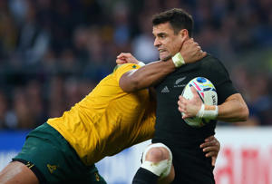 Dan Carter of the New Zealand All Blacks is hit by a high tackle by Sekope Kepu of Australia during the 2015 Rugby World Cup Final match between New Zealand and Australia at Twickenham Stadium on October 31, 2015 in London, United Kingdom.