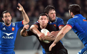 France's Paul Gabrillagues tackles New Zealand's Ryan Crotty and is given a yellow card for a high tackle.