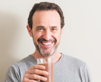 Man drinking chocolate milk