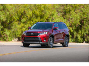 a car driving on a road: 2018 Toyota Highlander