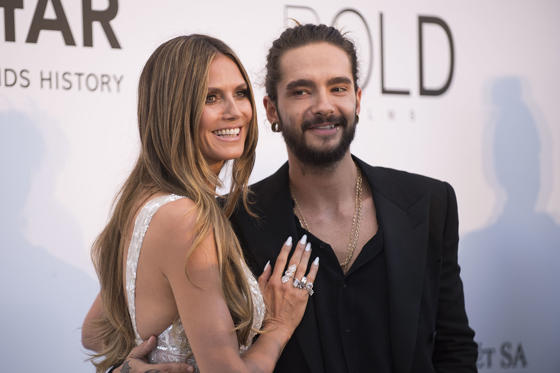 "Slide 1 of 10: At the Emmy Awards this week, there was more than a little red carpet buzz about the status of Heidi Klum's relationship with her boyfriend, Tom Kaulitz. That was thanks to the enormous diamond ring she wore on her left hand -- and continued wearing the next day on ""America's Got Talent."" Turns out a ring is just a ring. ""I don't know why everyone keeps saying that [I'm engaged]. Everyone is asking me,"" she told People. ""When you do what I do, you wear a lot of fashion. A lot of jewelry. I always look for something that goes with the outfit. So, I wear big rings. There is nothing more to it than that. Tomorrow I have to give it back,"" she said, adding, ""Sad."" The other thing people have been inquiring of the 45-year-old seems to be the age difference between her and her beau, who's 29. ""My boyfriend is many years younger than me, and lots of people are questioning that and asking about it,"" she recently told InStyle (via the Daily Mail). ""That's really the only time when age seems to be shoved in my face and I have to give an answer for it. I don't really think about it that much otherwise. You have to just live a happy life without worrying too much about what people think because worrying is only going to give you more wrinkles."" Touche.RELATED: New celebrity couples of 2018"