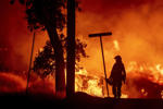 A firefighter lights backfires during the Carr fire in Redding, California on July 27. One firefighter has died and at least two others have been injured as wind-whipped flames tore through the region. - One person has died and at least two others have been injured as wind-whipped flames tore through the region.
