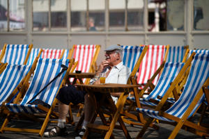 BLACKPOOL, ENGLAND - JULY 27:  People relax and soak up the sun on the North Pier on the promenade on July 27, 2018 in Blackpool, England. The heatwave continues across the United Kingdom with media outlets describing today as 'Furnace Friday' after all time record temperatures were predicted by forecasters. The unusual weather pattern is causing traffic and transport delays and is set to bring storms to eastern areas overnight.  (Photo by Christopher Furlong/Getty Images)