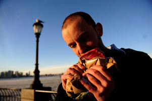 Caveman' Vlad Averbukh, 29, a follower of 'The Paleo Diet,' eats raw meat along the Hudson River in New York, February 04, 2010.