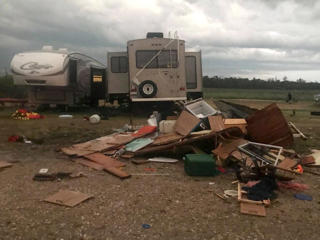 Debris is strewn about after a tornado at Margaret Bruce Beach, east of Alonsa, Man., on Friday, Aug.3, 2018. A tornado that touched down west of Lake Manitoba on Friday night tore at least one home off its foundation, a spokesman for Environment Canada said Saturday.