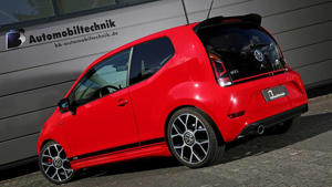 a red car parked on the side of a building: VW Up! GTI by B&B Automobiltechnik