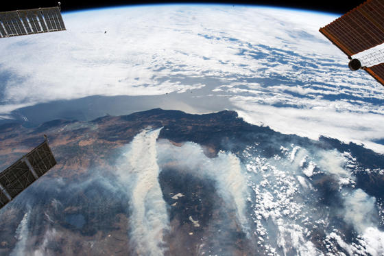 Slide 1 of 37: NASA astronaut Ricky Arnold captured Earth observation imagery of wildfires on Aug. 3, 2018, from his vantage point aboard the International Space Station. The largest wildfire ever recorded in California needed just 11 days to blacken an area nearly the size of Los Angeles — and it's only one of many enormous blazes that could make this the worst fire season in state history. ( Ricky Arnold/NASA via AP)