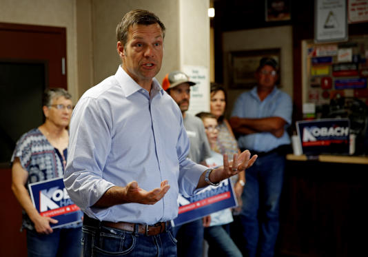 Kansas Secretary of State Kris Kobach and candidate for the Republican nomination for Kansas Governor addresses supporters during a campaign stop Friday, Aug. 3, 2018, at the Fort Scott Livestock Market in Fort Scott, Kan. (AP Photo/Charlie Riedel)
