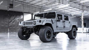 a large truck parked on the side of a vehicle: Mil-Spec Automotive Hummer M1