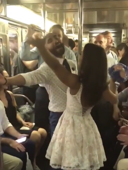 Watch commuters party with 2 newlyweds on the New York subway
