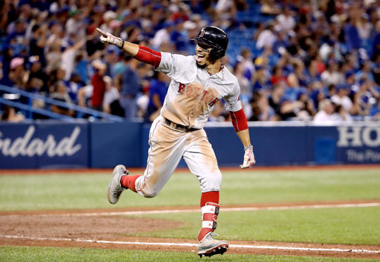 Slide 1 of 19: TORONTO, ON - AUGUST 9: Mookie Betts #50 of the Boston Red Sox celebrates as he hits a solo home run to complete the cycle in the ninth inning during MLB game action against the Toronto Blue Jays at Rogers Centre on August 9, 2018 in Toronto, Canada. (Photo by Tom Szczerbowski/Getty Images)