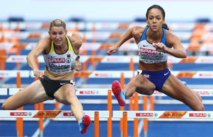 BERLIN, GERMANY - AUGUST 09:  Katarina Johnson-Thompson of Great Britain and Carolin Schaefer of Germany compete in the Women's Heptathlon 100 metres hurdles during day three of the 24th European Athletics Championships at Olympiastadion on August 9, 2018 in Berlin, Germany. This event forms part of the first multi-sport European Championships.  (Photo by Michael Steele/Getty Images)