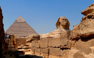 The Great Sphinx of Giza set against the Pyramid of Khufu