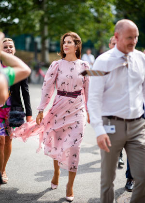 Danish Crown Princess Mary of Denmark, Mary Elizabeth Donaldson wearing pink dress with belt is seen outside CIFF fair during the Copenhagen Fashion Week Spring/Summer 2019 on August 8, 2018 in Copenhagen, Denmark.