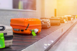Suitcase or luggage with conveyor belt in the airport.