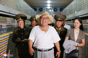 North Korean leader Kim Jong Un visits a factory in this undated photo released by North Korea's Korean Central News Agency (KCNA) on August 7, 2018.