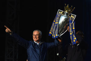 LEICESTER, ENGLAND - MAY 16:  (L-R) Claudio Ranieri Manager of Leicester City and captain Wes Morgan of Leicester City show the trophy to the fans during the Leicester City Barclays Premier League winners bus parade on May 16, 2016 in Leicester, England.  (Photo by Laurence Griffiths/Getty Images)