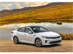 a car parked in front of a mountain: 2018 Kia Optima