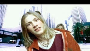 Taylor Hanson looking at the camera: Vote for your favourite boy band here: https://www.udiscovermusic.com/stories/best-boy-bands/ Listen to more from Hanson: https://lnk.to/HansonEstls  Follow Hanson https://www.facebook.com/hansonmusic/ https://twitter.com/hansonmusic https://www.instagram.com/hanson/  Music video by Hanson performing MMMBop. (C) 1997 The Island Def Jam Music Group