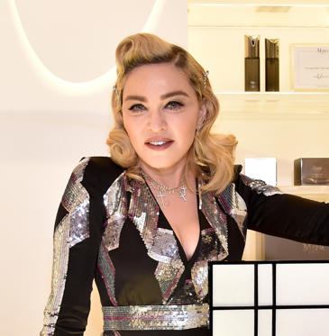 Slide 2 of 45: CAPTION: BEVERLY HILLS, CA - MARCH 06: Madonna visits MDNA SKIN Counter at Barneys New York, Beverly Hills on March 6, 2018 in Beverly Hills, California. (Photo by Kevin Mazur/Getty Images for Madonna's MDNA SKIN)