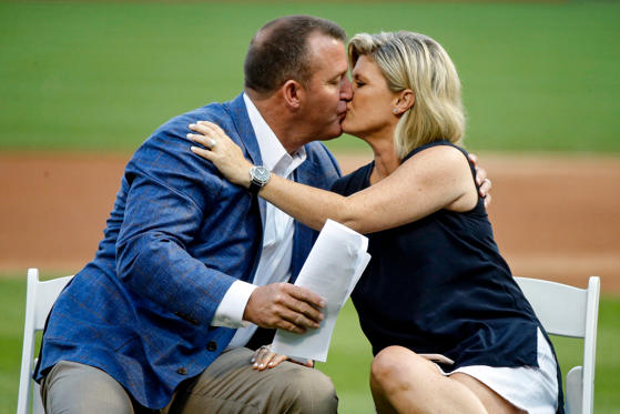 Slide 1 of 75: CHICAGO, IL - AUGUST 11: Newly inducted Hall of Famer Jim Thome kisses his wife Andrea Thome during a ceremony before the game between the Chicago White Sox and the Cleveland Indians at Guaranteed Rate Field on August 11, 2018 in Chicago, Illinois.