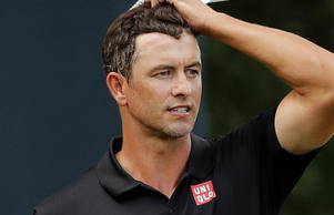 Adam Scott, of Australia, looks at his shot after he chipped onto the 16th green.