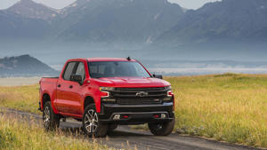 a car parked in front of a mountain: 2019 Chevrolet Silverado: First Drive