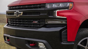 a red and black truck sitting on top of a car: 2019 Chevrolet Silverado: First Drive