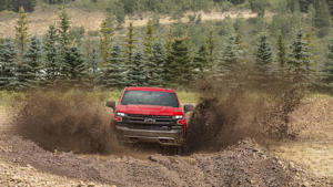 a truck driving down a dirt road: 2019 Chevrolet Silverado: First Drive