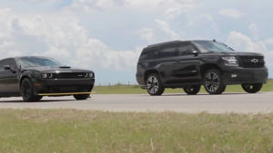 a car parked on the side of a road: Tahoe Drag Races Challenger Hellcat