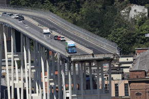 TOPSHOT - This general view taken on August 15, 2018, shows abandoned vehicles on the Morandi motorway bridge the day after a section collapsed in the north-western Italian city of Genoa. - At least 38 people were killed on August 14, when the giant motorway bridge collapsed in Genoa in northwestern Italy. The collapse, which saw a vast stretch of the A10 freeway tumble on to railway lines in the northern port city, was the deadliest bridge failure in Italy for years, and the country's deputy transport minister warned the death toll could climb further. (Photo by Valery HACHE / AFP)        (Photo credit should read VALERY HACHE/AFP/Getty Images)